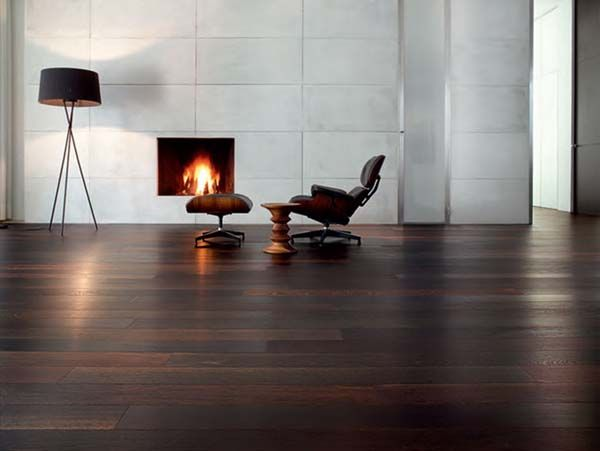 nice mat mooden flooring, like how the fireplace is flush and the wall tiling is very modern