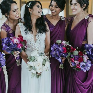 Wedding bouquets - Bridesmaids with colourful orchids, succulents and seasonal florals and the Bride with with all white and green.  Photography by Jonathan David Photography.