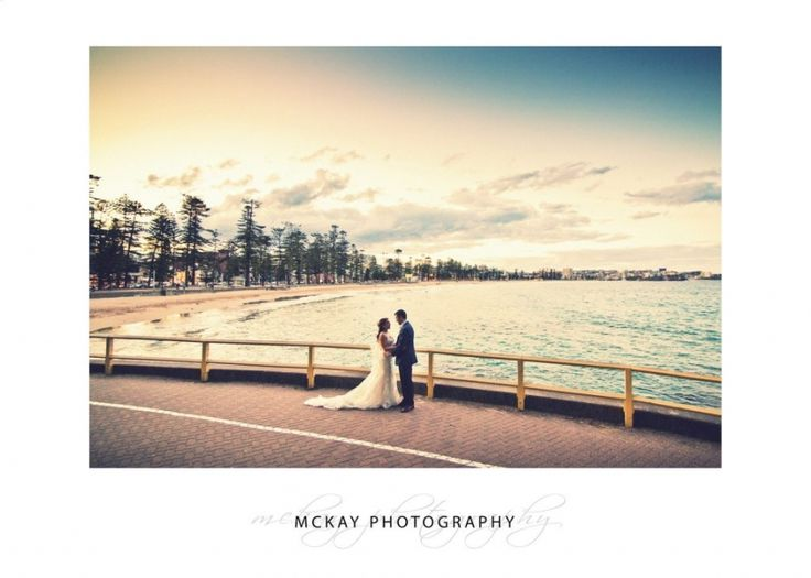 Sunset wedding photo looking out over Manly Beach