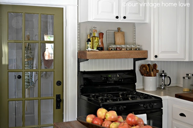 Take out the microwave above the stove, and install a shelf for frequently used kitchen items like olive oils and spices