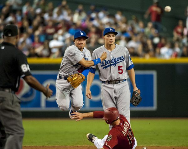 Corey Seager Photos Photos - Infielder Ronald Torreyes #59 of the Los Angeles Dodgers throws over Nick Ahmed #13 of the Arizona Diamondbacks in a double play attempt as Corey Seager #5 (R) looks on during a MLB game on September 13, 2015 at Chase Field in Phoenix, Arizona. - Los Angeles Dodgers v Arizona Diamondbacks