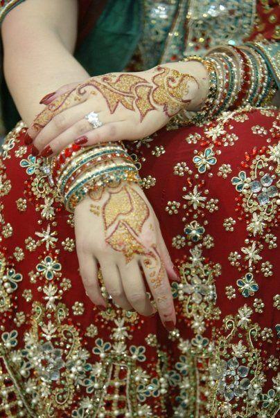 So beautifuuuuul.  Bridal mehndi (henna), bangles, saree.