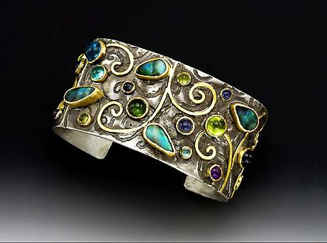 Cuff Bracelet | Laurie MacAdam.  Boulder Opal, Iolite, Amethyst, Peridot, Apatite, Sterling Silver and 18 Karat gold