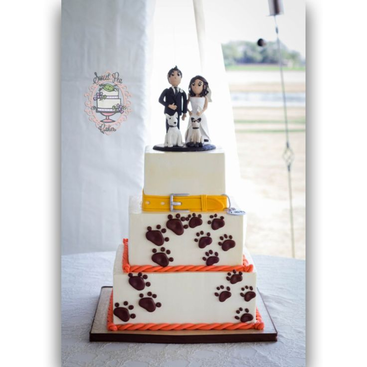 A dog lovers wedding cake. Buttercream with fondant details and clay topper. #wedding #weddingcake