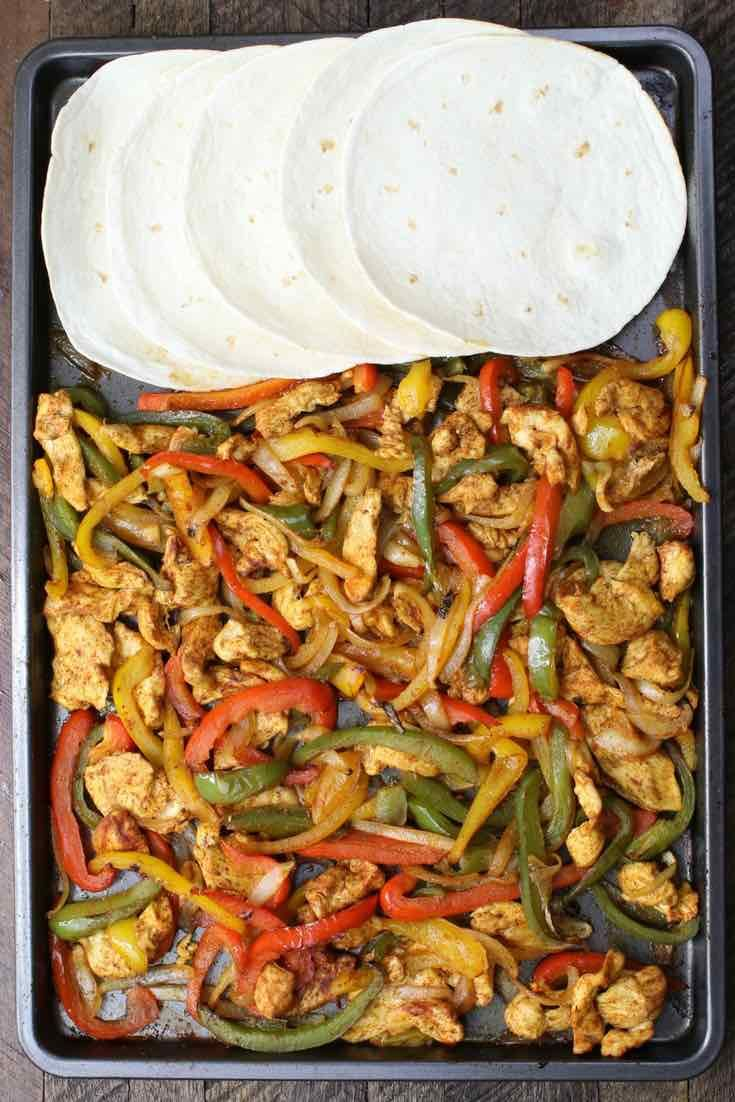 These Sheet Pan Chicken Fajitas make a delicious lunch or dinner - easy to make in 20-30 minutes with our video recipe!