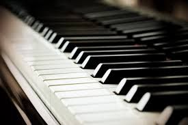 Sitting behind a piano.......while all alone.  Nothing like MUSIC!!!