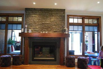 Modern custom built natural wood fireplace mantle.  Signature Custom Cabinets Inc.  www.signaturecustomcabinets.com