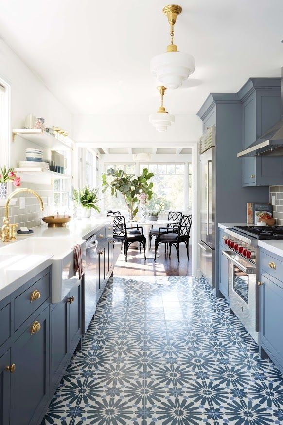 From The Brass Fixtures To Blue Gray Cabinets Graphic Caustic Tiled Floors