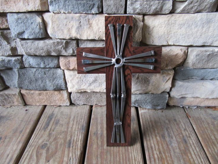Hand scraped flooring and masonry nail cross by JPlaiaSteelArt