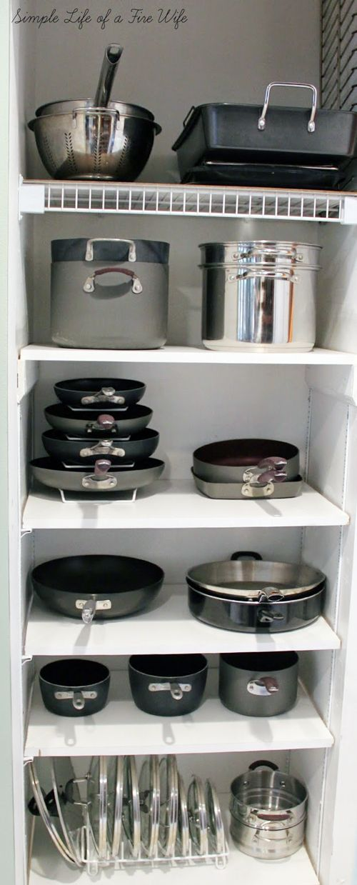 A brilliant divided cupboard for organising pots, pans and lids in the kitchen so everything is beautifully organised