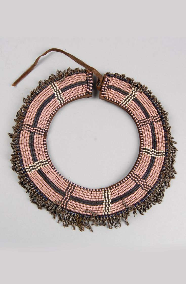 Southeast Africa | Necklet; hide, glass beads, steel and brass.  Possibly from Tanzania | ca. 1890 or earlier