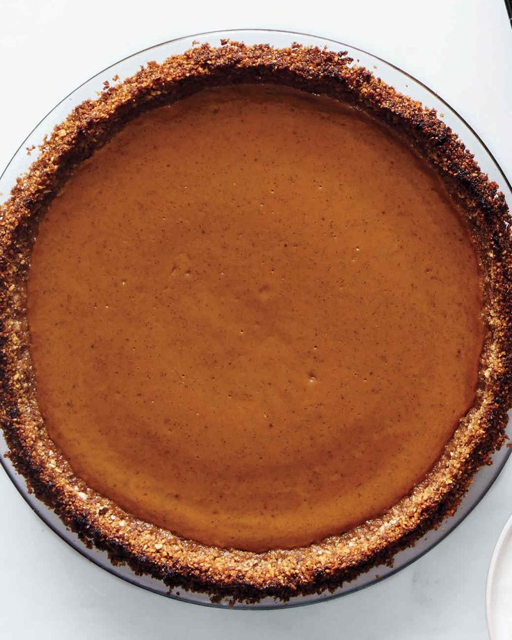 Spiced Pumpkin Pie | Martha Stewart Living - The secret weapon in our gluten-free baking arsenal? Crisp Rice-Almond Piecrust. It pairs beautifully with cinnamon- and nutmeg-spiked pumpkin filling and would be a superb base for just about any pie you please.