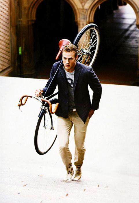 dark blue white striped vest, grey tee, beige pants, bike / men fashion