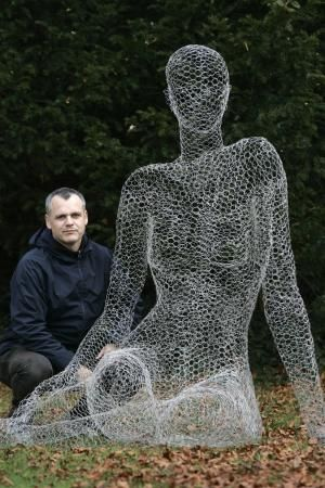 Chicken wire sculpture is pretty easy, and makes a good garden armature. I want to do something like this, fill her with soil, cover with burlap, put her in a tin tub, plant foamy white flowers for bubbles, ivy for the body, and potato vine for the hair