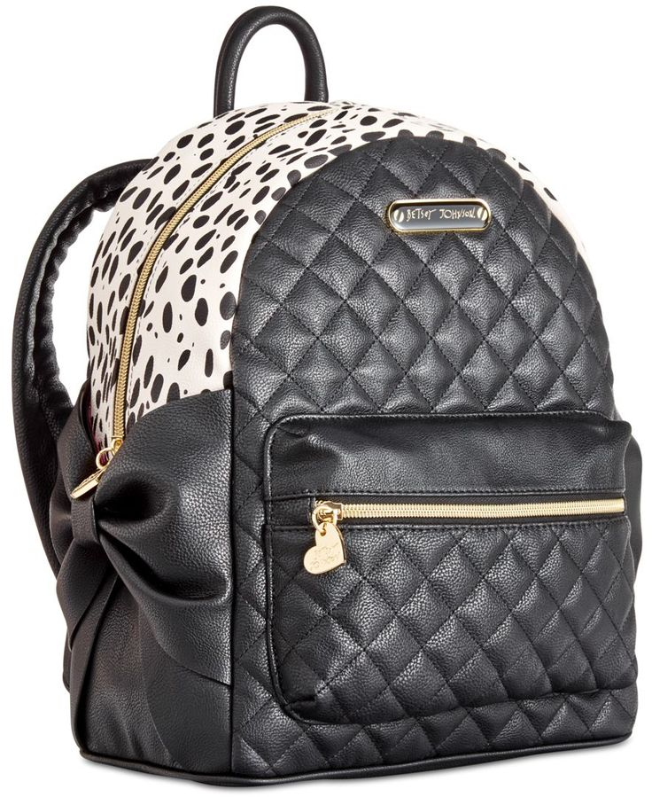 "Keep it cute on campus with Betsey Johnson's adorable faux leather backpack, featuring side slip pockets that work like a charm! | Faux leather | Imported | Medium sized bag; 13""W x 10-1/2""H x 5""D 