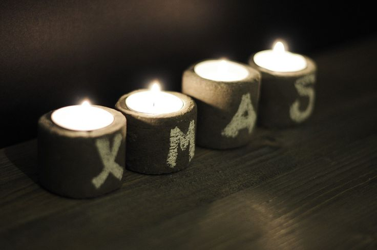 Cement candle holders decorated for Christmas!