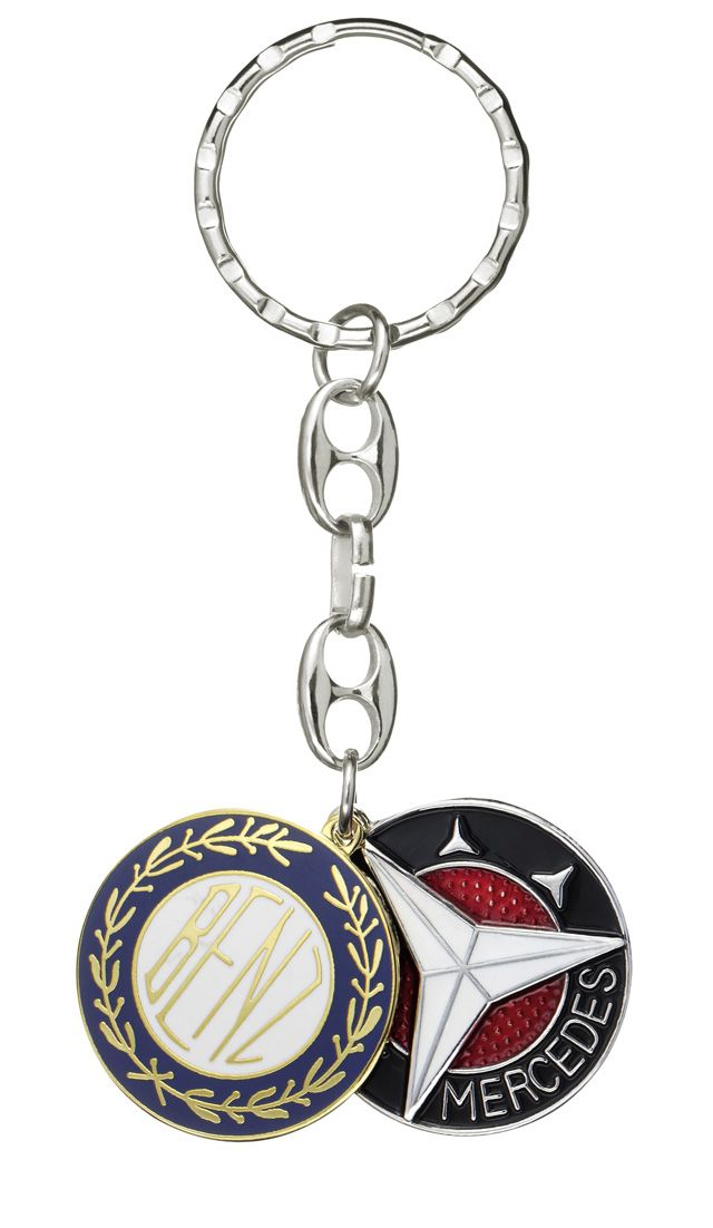 Part number:     B66043063 Colour:     silver/blue/black Material information:     brass  Key ring. Silver-coloured/blue/black. Brass. Fobs in form of 1909 and 1916 Mercedes-Benz logos. Diameter approx. 27 mm.