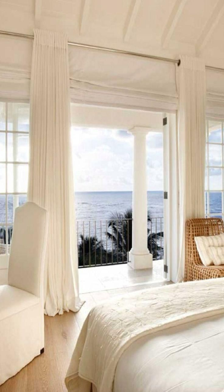 A White Beach House With Perfectly Breezy Curtains A White