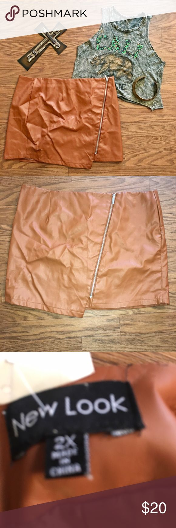 New look 2x brown vegan leather skirt with zipper New look 2x brown vegan leather skirt with side zipper.. mini length, Carmel brown, polyurethane, Rayon and poly.. stylish skirt has a few black small markings pic above nothing major.. pre-owned skirt look at pic and ask questions I may sometimes overlook a flaw sometimes I try my best to overlook all my items properly!! New Look Skirts Mini
