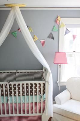A gender neutral shared baby girl and boy nursery with diy for Diy canopy over crib