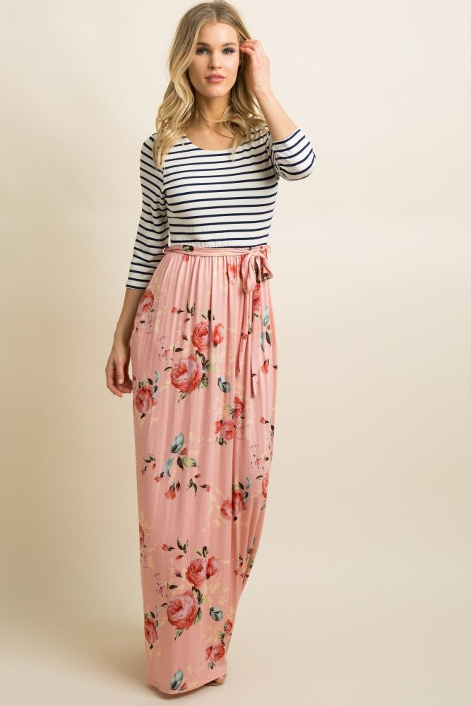 f7ec90daede6 A colorblock maxi dress with a striped top and a floral print skirt.  Additional details include 3/4 sleeves, a rounded neckline, a cinched  elastic waistline ...