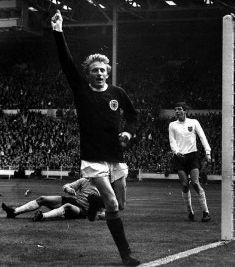 Scotland's joint record goal scorer Dennis Law celebrates a goal against England
