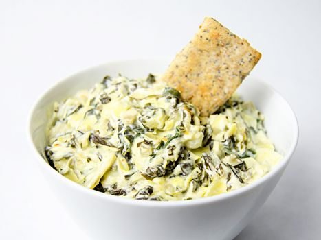 When TV personality Kristin Cavallari's husband, Chicago Bears quarterback Jay Cutler, plays out of town, she invites her friends over for a game day viewing party and makes her signature spinach-artichoke dip. Check out her recipe and tips for throwing a fun football bash!