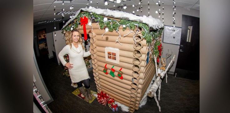 A Minnesota woman has upped the cubicle decoration game for office workers everywhere by transforming her desk space into a log cabin Christmas wonderland.Angela Westfield, 29, entered work to a standing ovation Monday from coworkers who had walked into their office surprised by the sight of...