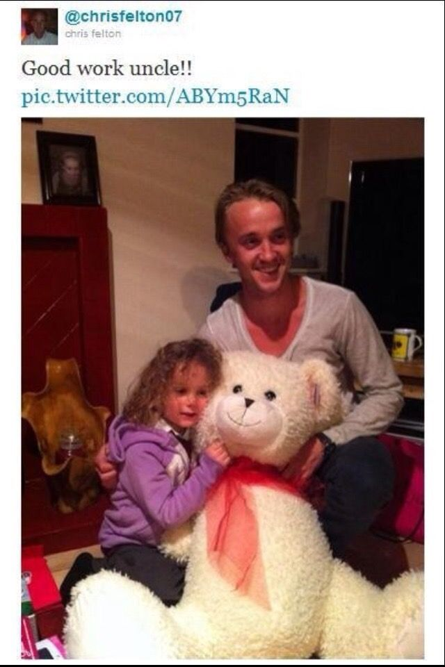 Does this little girl even realize how many people would give an arm and a leg to get a giant stuffed bear from Tom Felton?!?!