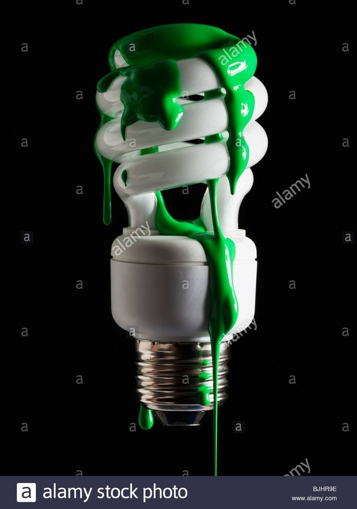 Download this stock image: Light bulb covered in green paint - BJHR9E from Alamy's library of millions of high resolution stock photos, illustrations and vectors.