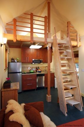 Ladder In Small House Wood Railing And Kitchen
