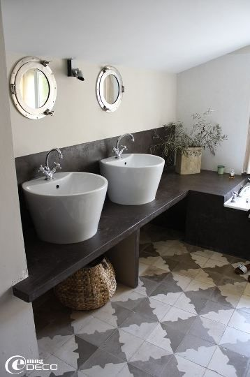 #gray floor, vessel sink and counter top = wonderful design elements. I would change the mirrors.