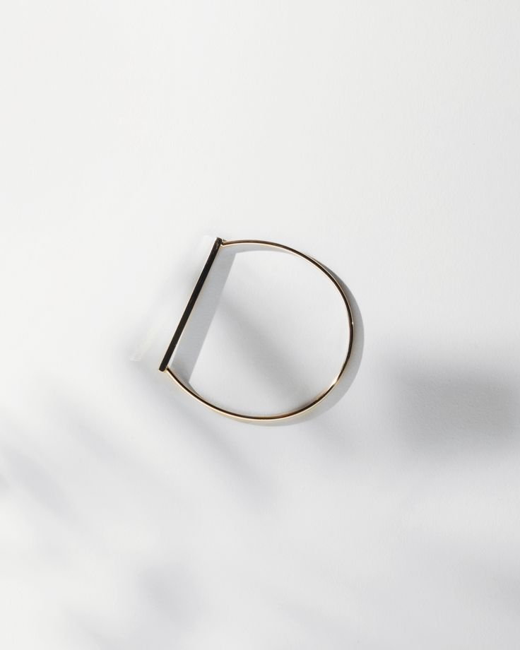A minima half circle bracelet will match any outfit for any occasion.