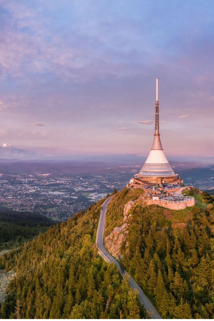 Ještěd Czech Republic: Experience Ještěd's perfect harmony of nature and architecture! At first glance, it may appear that a spaceship has landed on the peak of the majestic Ještěd Mountain. Click here to find out what exactly this structure is!