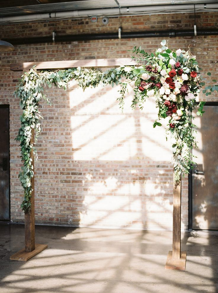 Wooden ceremony arbor with burgundy and blush floral and greenery by La Rue Floral, Photography by Nicole Clarey Photography