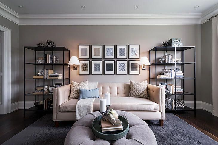 Love the pictures above the couch, open shelving, …