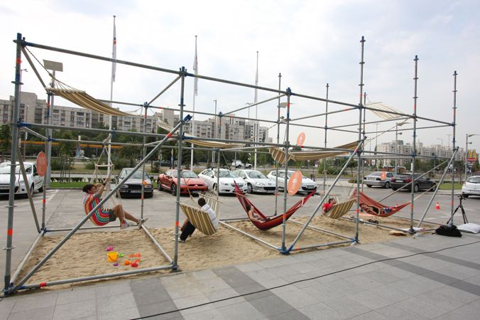 in front of the HQ of Vivacom we installed this temporary scaffold construction, added some natural sand and hammocks to bring the summer back in town.  16.09.2011  Sofia