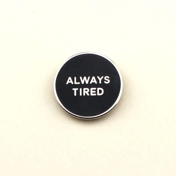 "I'm not sleeping, I'm just resting my eyes. Five more minutes. This enamel pin measures .85"" wide and comes mounted with a secure rubber pin back."