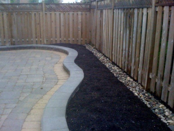 landscaping with river rocks along fence lines allows you to not have to pull weeds - Garden Ideas Along Fence Line