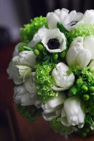 Beautiful bridal bouquet of white anemone wedding flowers for the bride on her wedding day by doreen.wilson.395