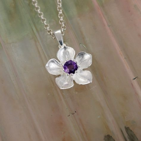 """Amethyst Posy Pendant £32.00 What is more natural than a fabulous amethyst set in a sterling silver flower pendant? All of our silver jewellery comes beautifully packaged in our new Christin Ranger branded boxes. Look for us in the September issue of """"Good Housekeeping""""."""