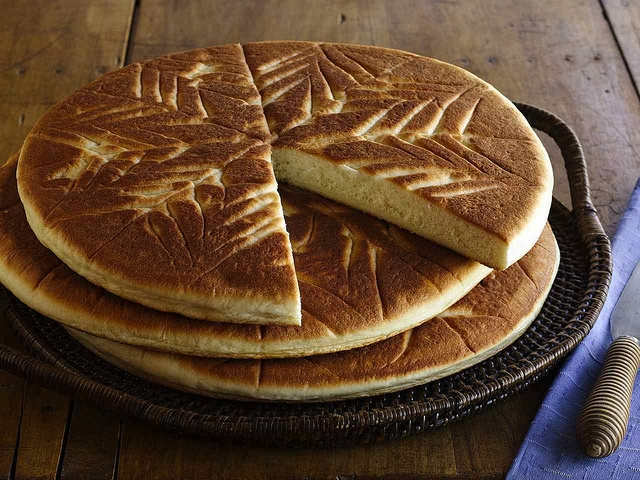 Himbasha is an Ethiopian and Eritrean celebration bread that is slightly sweet. It is often served at special occasions. It is prepared in a number of varieties, however the most distinctive flavoring is ground cardamom seeds.  The dough is given a decorative touch before baking. The design varies in detail, but in general is given the shape of a wheel with indentations to create several spokes.  Common additions include (candied) ginger or raisins.