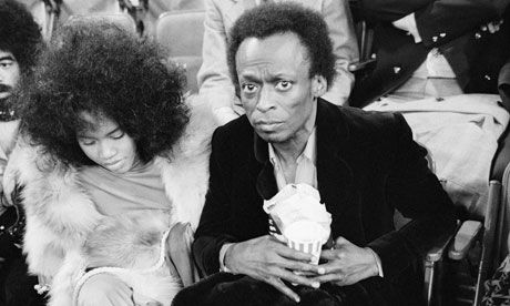 Betty and Miles Davis ringside at the Muhammad Ali-Joe Frazier title fight in New York, 1971. Photograph: Michael Ochs Archives/Corbis