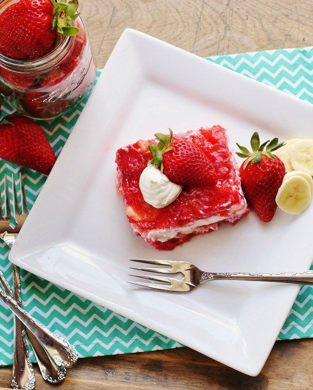 An Aerial View Of A Square Of Strawberry Congealed Salad Topped With A Strawberry And A Dollop Of Sour Cream Jello Salad Strawberry Jello Salad Congealed Salad
