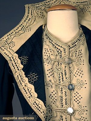 HIGH STYLED BLACK WOOL BODICE, c. 1900 Black & cream wool felt w/ contrasting black & cream embroidery & soutache, silver military style buttons. Detail