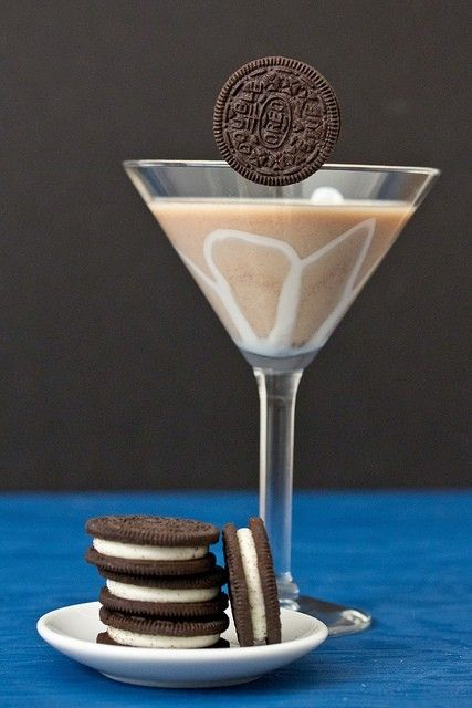 Oreo Martini:    Ingredients:  ice cubes  1½ ounces vodka  1½ ounces Kahlüa   1½ ounces white crème de cacao   1½ ounces Baileys Irish Cream   2 Oreo cookies, for garnish     How to make it:  *Fill a cocktail shaker halfway with ice cubes  *Add the vodka, Kahlüa, crème de cacao and Baileys and shake well. *Strain into 2 martini glasses  *Slip an Oreo onto the side of each glass