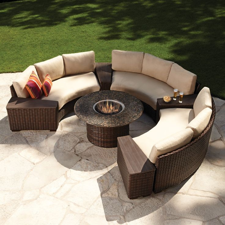 Modern outdoor wicker circular patio sectional with stone top fire table. Available in a beautiful dark brown rattan peel wicker colors with 250+ outdoor fabrics for the cushions