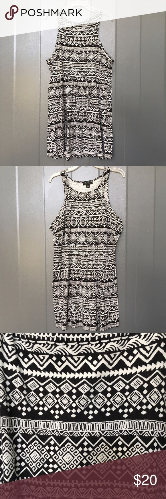 """Aztec print dress f21 plus Worn once for a special occasion, never worn again. In Perfect condition. I Had it professionally hemmed, to fit my height better, I'm 5'5  (Dress Measurements below)  Soft ,stretchy, lightweight material, not uncomfortable at all. Front is similar to a halter since it comes in and you might need a strapless bra, but back is completely covered.(Last pic) Material: 100% cotton MEASUREMENTS Laying flat (inches) Chest: 22"""" Waist: 19 1/2"""" Shoulder to hem: 36"""" Hips…"""