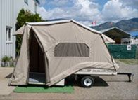 Lees-ure Lite is a ultra light tent trailer designed to be pulled by a large motercycle or small car.   The Excel model fits a full sized bed in width but with king/queen length.  A custom mattress is one of the options.