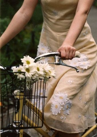 whimsical bike ride. flowers matching your skirt. how perfect is that?  #garnethill #summerstyle